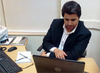 Surgeon Belal sitting at his desk